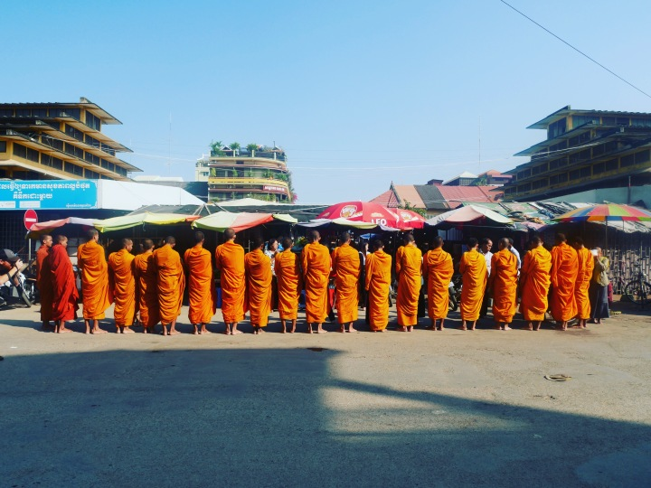 Buddhist monks on their daily round